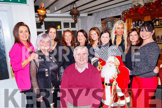 Dan Horan, seated, celebrated with his staff from Horans health foods, their Christmas party in Linnanes bar, Tralee last Saturday night, Dec 14, Back L-R Deirdre Murphy, Tess Breen, Clover Wharton, Noreen Irwin, Joan Ahern, Bina&Abina Lindane, Sandra Breen, Delia Galvin and Shelia McQuinn.
