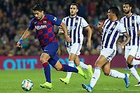 29th October 2019; Camp Nou, Barcelona, Catalonia, Spain; La Liga Football, Barcelona versus Real Valladolid; Luis Suarez muscles his way past two defenders