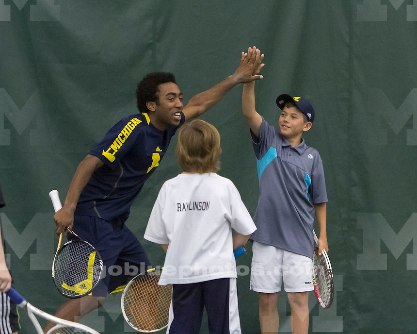 The University of Michigan men's tennis team beat Northwestern, 6-1, at the Varsity Tennis Center in Ann Arbor, Mich., on April 7, 2013.