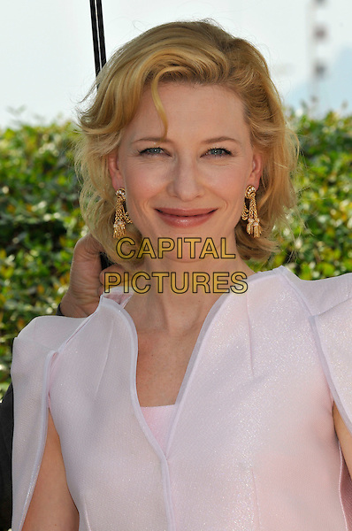 "CATE BLANCHETT.""Robin Hood' photocall.63rd International Cannes Film Festival, France.12th May 2010.headshot portrait pink gold earrings.CAP/PL.©Phil Loftus/Capital Pictures."