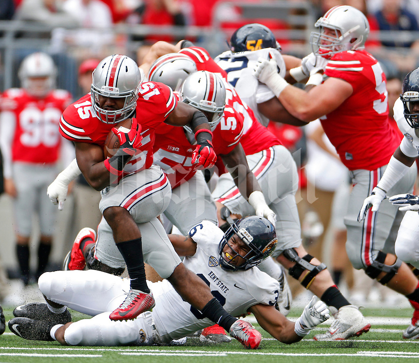 Ohio State Buckeyes running back Ezekiel Elliott (15) breaks away from Kent State Golden Flashes linebacker Darius Redmond (36) in the 2nd quarter of their game in Ohio Stadium on September 13, 2014.  (Dispatch photo by Kyle Robertson)