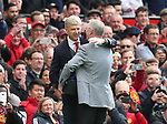 Arsene Wenger manager of Arsenal is greeted by former manager Sir Alex Ferguson who presents him with a gift during the premier league match at the Old Trafford Stadium, Manchester. Picture date 29th April 2018. Picture credit should read: Simon Bellis/Sportimage