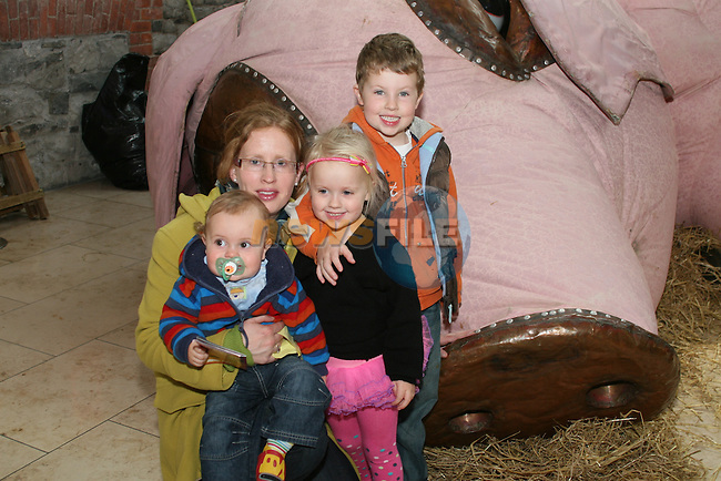 Connor, Éile, Diarmuid and Caoimhe Loughman enjoy the Huge Inflatable sleeping pig in Scotch Hall as part of Leanbh Childrens Festival..Photo NEWSFILE/Jenny Matthews.(Photo credit should read Jenny Matthews/NEWSFILE)....This Picture has been sent you under the condtions enclosed by:.Newsfile Ltd..The Studio,.Millmount Abbey,.Drogheda,.Co Meath..Ireland..Tel: +353(0)41-9871240.Fax: +353(0)41-9871260.GSM: +353(0)86-2500958.email: pictures@newsfile.ie.www.newsfile.ie.FTP: 193.120.102.198.