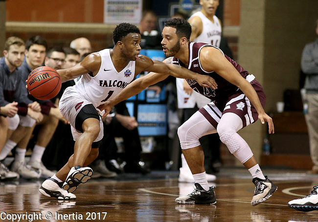SIOUX FALLS, SD: MARCH 23: Jason Jolly #1 from Fairmont State looks to drive past Nick Fredrick #24 from Bellarmine during the Men's Division II Basketball Championship Tournament on March 23, 2017 at the Sanford Pentagon in Sioux Falls, SD. (Photo by Dave Eggen/Inertia)