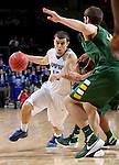 SIOUX FALLS, SD - MARCH 7:  Max Landis #10 of Fort Wayne dribbles past defender Chris Kading #34 of North Dakota State in the 2016 Summit League Tournament.  (Photo by Dave Eggen/Inertia)