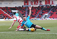 Lewis Coyle of Fleetwood Town appeals for a foul against Luke McCullough of Doncaster Rovers during the Sky Bet League 1 match between Doncaster Rovers and Fleetwood Town at the Keepmoat Stadium, Doncaster, England on 17 February 2018. Photo by Leila Coker / PRiME Media Images.