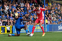 Deji Oshilaja of AFC Wimbledon and James Perch of Scunthorpe United during AFC Wimbledon vs Scunthorpe United, Sky Bet EFL League 1 Football at the Cherry Red Records Stadium on 15th September 2018