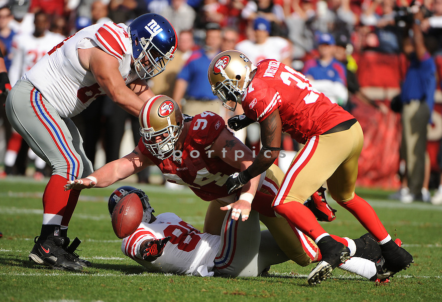 JUSTIN SMITH, of the San Francisco 49ers, in action during the 49ers game against the New York Giants on November 13, 2011 at Candlestick Park in San Francisco, CA. The 49ers beat the Giants 27-20.