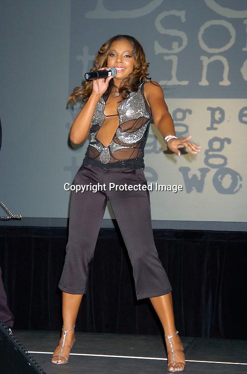 Ashanti singing..at the Do Something Brick Awards on April 8, 2004 at the ..Metropolitan Pavillion...Photo by Robin Platzer, Twin Images