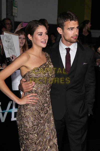 WESTWOOD, CA - March 18: Shailene Woodley &amp; Theo James at the &quot;Divergent&quot; Los Angeles Premiere, Regency Bruin Theatre, Westwood,  March 18, 2014. <br /> CAP/MPI/JO<br /> &copy;Janice Ogata/MediaPunch/Capital Pictures