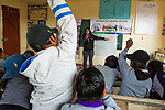 Andean Mountain Cat (Leopardus jacobita) biologist, Alejandra Rocio Torrez Tarqui, explaining to school children the difference between carnivores and herbivores during an educational outreach program, Ciudad de Piedra, Andes, western Bolivia
