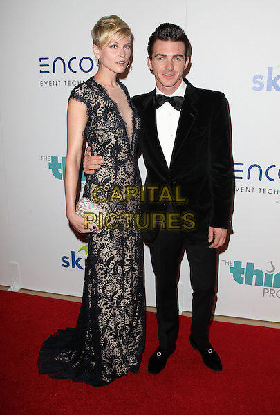 24 June 2014 - Beverly Hills, California - Paydin Lopachin, Drake Bell. 5th Annual Thirst Project Gala held at the Beverly Hilton Hotel. <br /> CAP/ADM/FS<br /> &copy;Faye Sadou/AdMedia/Capital Pictures