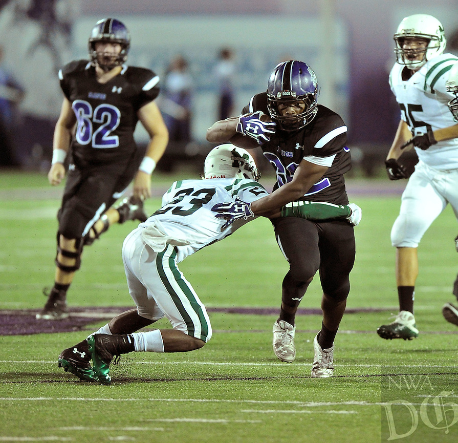NWA Democrat-Gazette/MICHAEL WOODS &bull; @NWAMICHAELW<br /> Fayetteville High School running back Javontae Smith (32) tries to get past Muskogee defender Travon Hughes (23)  during the first half of the Bulldogs game Friday September 18, 2015 in Fayetteville.