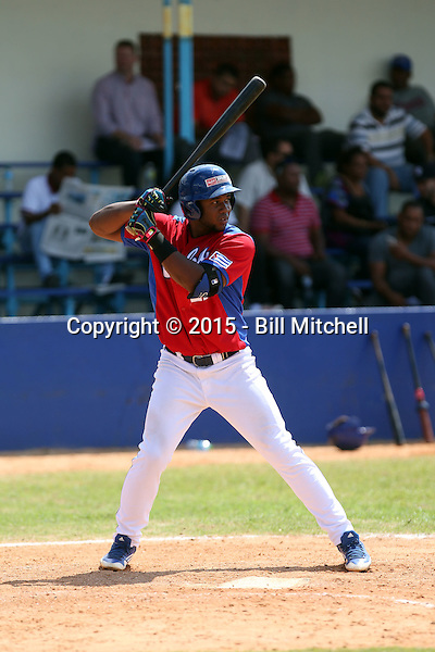 Edwin Vassel / Edwin Vasell works out at the Dominican Republic air force base in front of 100+ Major League Baseball scouts prior to being declared eligible to sign since defecting from his native Cuba in Santo Domingo, Dominican Republic on February 11, 2015 (Bill Mitchell)