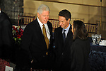Former U.S. President Bill Clinton talks with Treasury Secretary nominee Timothy Geithner and his wife Carole Sonnenfeld at the luncheon following Barack Obama's swearing in as the 44th President of the United States at Statuary Hall in the U.S. Capitol in Washington, DC on January 20, 2009.