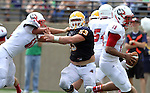 SIOUX FALLS, SD - SEPTEMBER 7:  Jake Lee #53 from Augustana tries to shake the block of Jack Bixler #60 while eying quarterback Demetrius Carr #15 from Minnesota State University Moorhead in the first quarter of their game Saturday at Augustana. (Photo by Dave Eggen/Inertia)