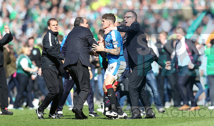 Rangers Andy Halliday is held back by Rangers security chief David Martin after the William Hill Scottish Cup Final match at Hampden Park Stadium.  Photo credit should read: Lynne Cameron/Sportimage via Sportimage