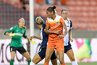 Houston, TX - Saturday July 15, 2017: Poliana Barbosa Medeiros heads the ball into Washington's goal during a regular season National Women's Soccer League (NWSL) match between the Houston Dash and the Washington Spirit at BBVA Compass Stadium.