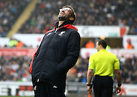Liverpool manager Jurgen Klopp laughs after a refereeing decision goes against his side on the touchline during the Barclays Premier League match between Swansea City and Liverpool played at the Liberty Stadium, Swansea on 1st May 2016