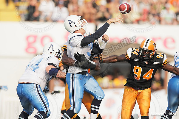 September 7, 2009; Hamilton, ON, CAN; Hamilton Tiger-Cats linebacker Otis Floyd (35) rushes Toronto Argonauts quarterback Cody Pickett (3), forcing an incomplete pass. CFL football - the Labour Day Classic - Toronto Argonauts vs. Hamilton Tiger-Cats at Ivor Wynne Stadium. The Tiger-Cats defeated the Argos 34-15. Mandatory Credit: Ron Scheffler.