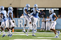 CHAPEL HILL, NC - SEPTEMBER 07: Tomon Fox #12 and his brother Tomari Fox #56 of the University of North Carolina celebrate a defensive stop during a game between University of Miami and University of North Carolina at Kenan Memorial Stadium on September 07, 2019 in Chapel Hill, North Carolina.
