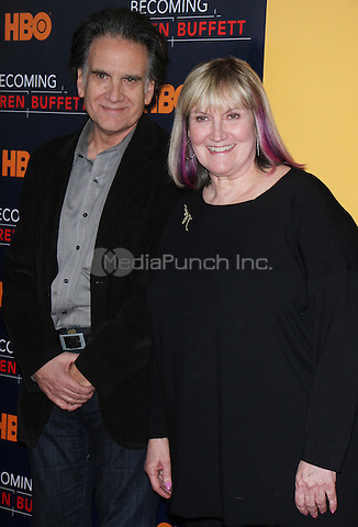 NEW YORK, NY January 19, 2017:Peter Buffett, Susie Buffett, attend the   HBO Documentart presents the World Premiere screening of Becoming Warren Buffett at Museum of Modern Art in New York .January 19, 2017. Credit:RW/MediaPunch