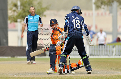 "T20 World Cup Qualifying match - Scotland V Netherlands at ICC Global Cricket Academy - Dubai - in the first ""cross-over"" semi-final - Netherlands (and Australia A) batsman Tom Cooper watches the ball carefully as it goes close to the wicket in front of Scots keeper Craig Wallace - Cooper was Pro at Wallace's Forfarshire CC a couple of seasons ago - Picture by Donald MacLeod  22.3.12  07702 319 738  clanmacleod@btinternet.com"