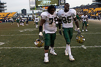 Walt Walker (75) and George Selvie (95) celebrate after the South Florida Bulls defeated the Pitt Panthers 48-37 on November 24, 2007 at Heinz Field, Pittsburgh, Pennsylvania.