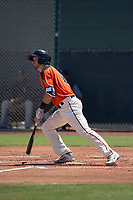 San Francisco Giants Orange catcher Trevor Brown (16) starts down the first base line during an Extended Spring Training game against the Seattle Mariners at the San Francisco Giants Training Complex on May 28, 2018 in Scottsdale, Arizona. (Zachary Lucy/Four Seam Images)