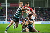 Picture by Alex Whitehead/SWpix.com - 01/05/2014 - Rugby League - First Utility Super League - St Helens v London Broncos - Langtree Park, St Helens, England - St Helens' Jon Wilkin is tackled by London's James Cunningham and Nick Slyney.