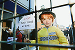 Finn Broderick age 5 pictured at the Protest in Croom , Co Limerick over the loss of Crooms last remaining bank branch and ATM, Ulster Bank.<br /> Coom has lost 2 banks in the last year and a half and its believed it will devastate business in the town.<br /> Pic. Brian Arthur/ Press 22.