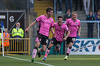 Teammates celebrate with Shaun Brisley of Northampton Town as he scores to make it 3-1 during the Sky Bet League 2 match between Wycombe Wanderers and Northampton Town at Adams Park, High Wycombe, England on 3 October 2015. Photo by Andy Rowland.