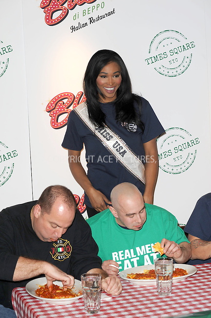 WWW.ACEPIXS.COM . . . . . .March 20, 2013...New York City.... Miss USA 2012 Nana Meriwether attends the Ravioli Day pasta eating contest at Buca Di Beppo in Times Square on March 20, 2013 in New York City ....Please byline: KRISTIN CALLAHAN - ACEPIXS.COM.. . . . . . ..Ace Pictures, Inc: ..tel: (212) 243 8787 or (646) 769 0430..e-mail: info@acepixs.com..web: http://www.acepixs.com .
