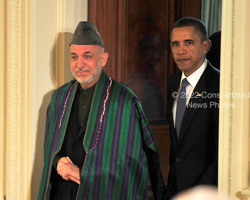 United States President Barack Obama, right, and President Hamid Karzai of Afghanistan, left enter the East Room of the White House in Washington, DC to hold a joint press conference on Wednesday, May 12, 2010..Credit: Ron Sachs / CNP