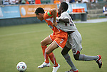 03 July 2012: Carolina's Kupono Low (3) defends against Atlanta's Borfor Carr (LBR) (19) with a jersey tug. The Carolina RailHawks defeated the Atlanta Silverbacks 2-1 at WakeMed Soccer Stadium in Cary, NC in a 2012 North American Soccer League (NASL) regular season game.