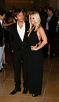 BEVERLY HILLS, CA. - October 02: Jessica Simpson (R) and Ken Paves arrive at Operation Smile's 8th Annual Smile Gala at the Beverly Hilton Hotel on October 2, 2009 in Beverly Hills, California.