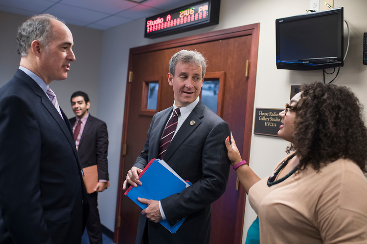 "UNITED STATES - APRIL 5: Sen Bob Casey, D-Pa., left, and Rep. Matt Cartwright, D-Pa., talk with an aide before a news conference in the Capitol Visitor Center to introduce miner's health care legislation the ""Black Lung Benefits Improvement Act of 2017"" and the ""Robert C. Byrd Mine Safety Protection Act of 2017,"" April 5, 2017. Rep. Bobby Scott, D-Va., and Sen. Joe Minchin, D-W.Va., also attended. (Photo By Tom Williams/CQ Roll Call)"