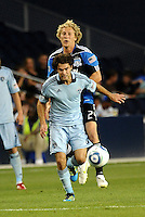 Graham Susi (blue) Sporting KC midfielder holds off Steven Lenhart (24) San Jose Earthquakes forward... Sporting KC defeated San Jose Earthquakes 1-0 at LIVESTRONG Sporting Park, Kansas City, Kansas.