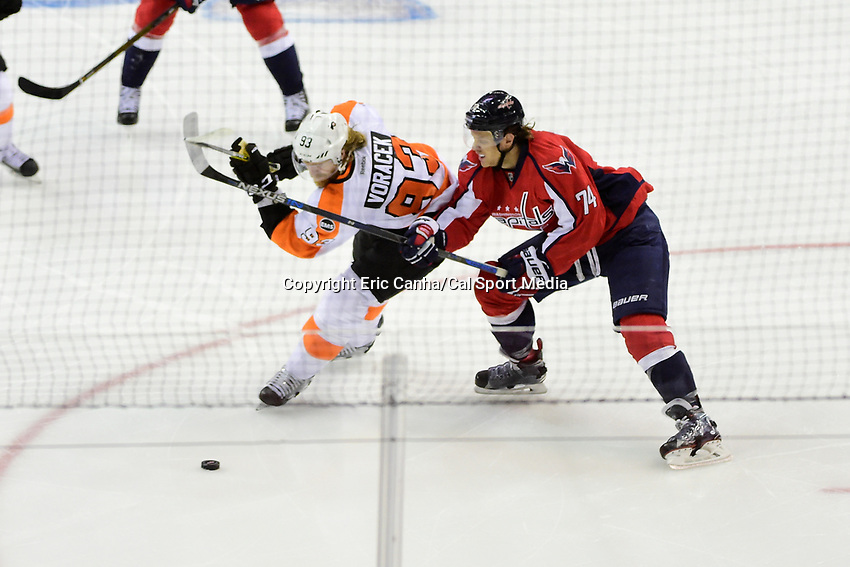 Thursday, April 14, 2016: Washington Capitals defenseman John Carlson (74) lifts the stick of Philadelphia Flyers left wing Jakub Voracek (93) during the game 1 of the first round of the National Hockey League Eastern Conference playoffs  between the Philadelphia Flyers and the Washington Capitals held at the Verizon Center in Washington, DC. Washington defeats Philadelphia 2-0. Eric Canha/CSM