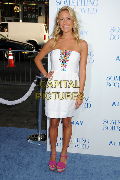 """KRISTIN CAVALLARI .""""Something Borrowed"""" Los Angeles Premiere held at Grauman's Chinese Theatre, Hollywood, California, USA, .3rd May 2011..full length white dress tanned hand on hip espadrilles wedges strapless beaded pink turquoise embellished  .CAP/ADM/BP.©Byron Purvis/AdMedia/Capital Pictures."""
