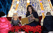 First lady Michelle Obama and Miss Piggy read a book to children from the stage during the National Christmas tree lighting ceremony on the Ellipse south of the White House December 3, 2015 in Washington, DC. The lighting of the tree is an annual tradition attended by the President and the first family.<br /> Credit: Olivier Douliery / Pool via CNP