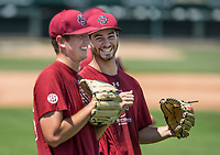 NWA Democrat-Gazette/BEN GOFF @NWABENGOFF<br /> Adam Hill (left) and Cody Morris, South Carolina pitchers, Friday, June 8, 2018, during practice for the NCAA Fayetteville Super Regional at Baum Stadium.
