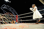 Streamers are thrown into the ring as the MC introduces a wrestler prior to a bout at Doglegs, an event for wrestlers with physical and mental handicaps in Tokyo, Japan.