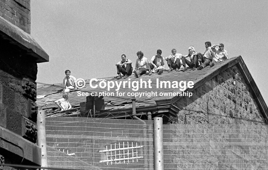 Prisoners protesting on the rooftop of the Crumlin Road Jail, Belfast, N Ireland, 20 July 1972. During the rooftop protest one prisoner was wounded by a shot from a sniper. MORE CAPTION INFO TO FOLLOW. 197207200419b.<br />