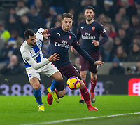 Brighton & Hove Albion's Martin Montoya (left) vies for possession with Arsenal's Aaron Ramsey (right)  <br /> <br /> Photographer David Horton/CameraSport<br /> <br /> The Premier League - Brighton and Hove Albion v Arsenal - Wednesday 26th December 2018 - The Amex Stadium - Brighton<br /> <br /> World Copyright © 2018 CameraSport. All rights reserved. 43 Linden Ave. Countesthorpe. Leicester. England. LE8 5PG - Tel: +44 (0) 116 277 4147 - admin@camerasport.com - www.camerasport.com