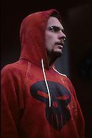 Portrait of a man wearing a Punisher hoody in London in 1996