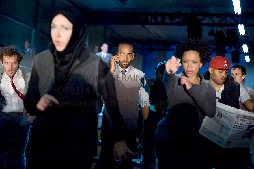 Decade. Based on the events of 9/11 directed by Rupert Goold. With Samuel James[ red tie], Kevin Harvey [on phone] . ArinzeKene [ on phone] Opens at Commodity Quay at St Katherine's Dock in London. Opens  on 7/9/11 . CREDIT Geraint Lewis
