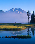 Deschutes National Forest, WA<br /> Summit of South Sister mountain (10,358 ft) rises above clearing morning fog on Sparks Lake