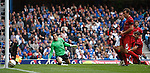 Nacho Novo's shot cannons off the post with Jamie Langfield beaten