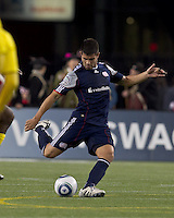 New England Revolution defender Franco Coria (2) passes the ball.  In a Major League Soccer (MLS) match, the Columbus Crew defeated the New England Revolution, 3-0, at Gillette Stadium on October 15, 2011.